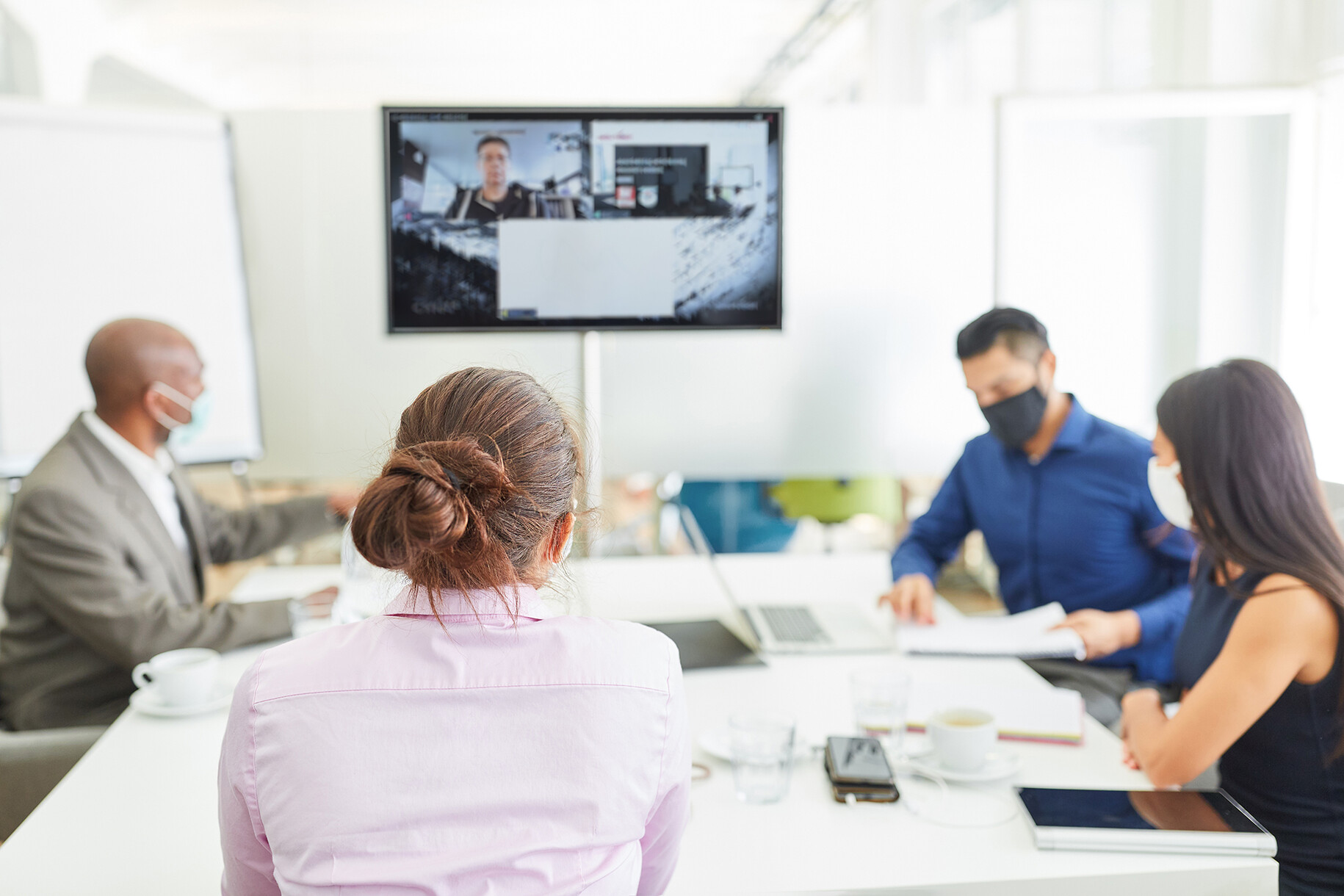 A consistent meeting experience for both in-person and remote attendees is essential.