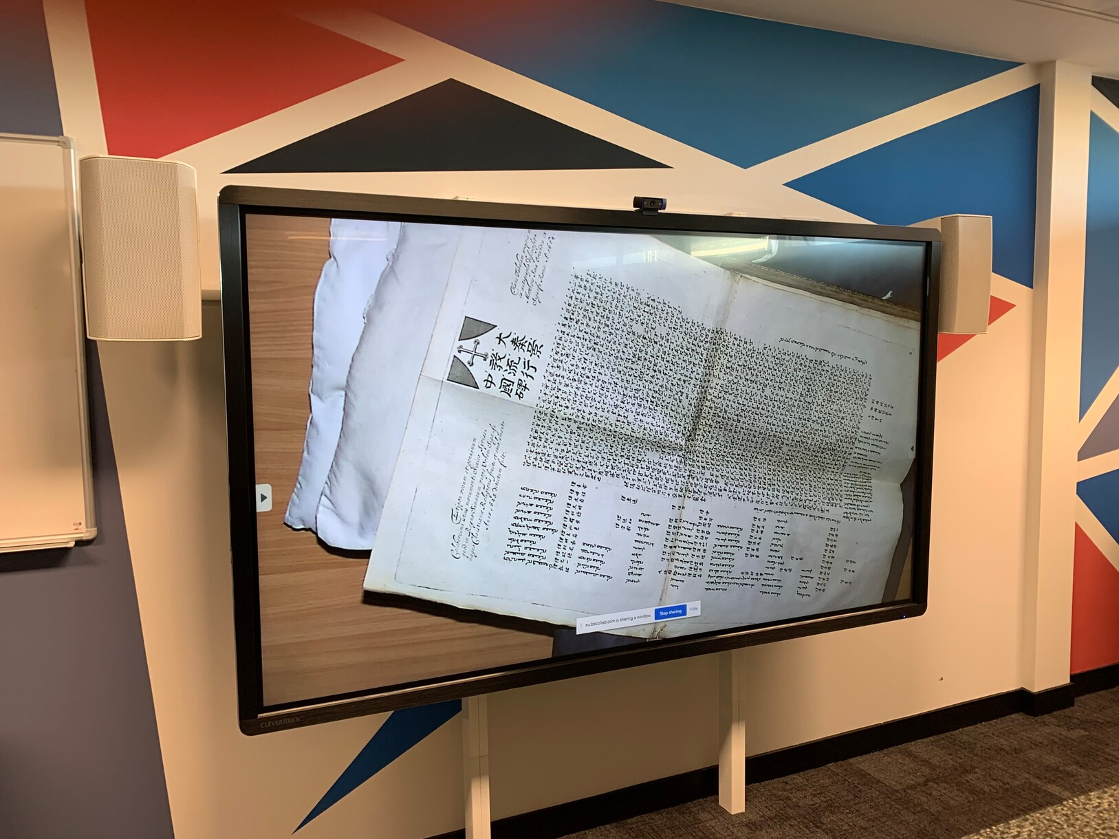 Rare books and other items displayed on-screen using a VZ-C6 Visualizer during online classes at The University of Edinburgh