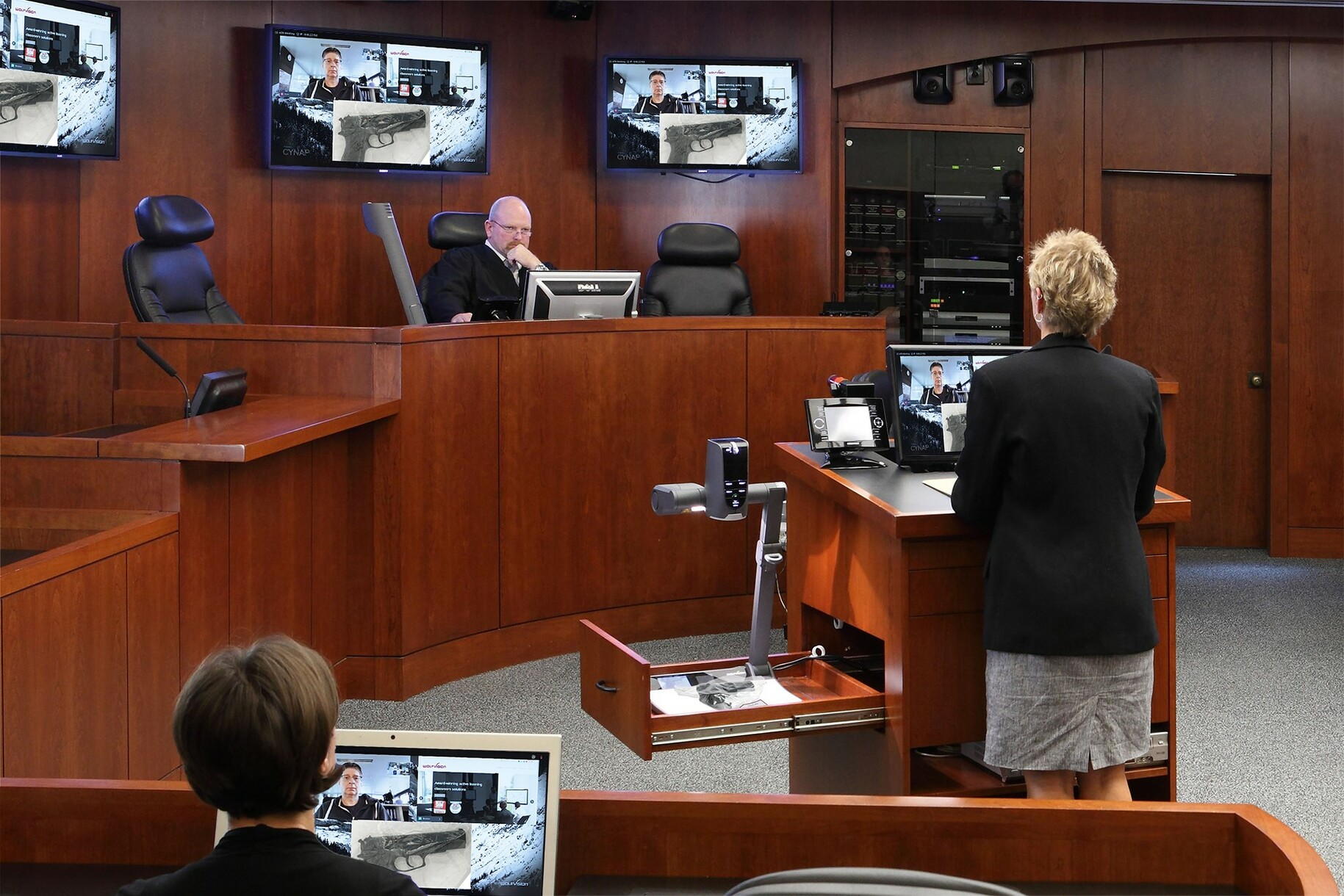 Enabling both in-person and remote participation in the court proceedings.