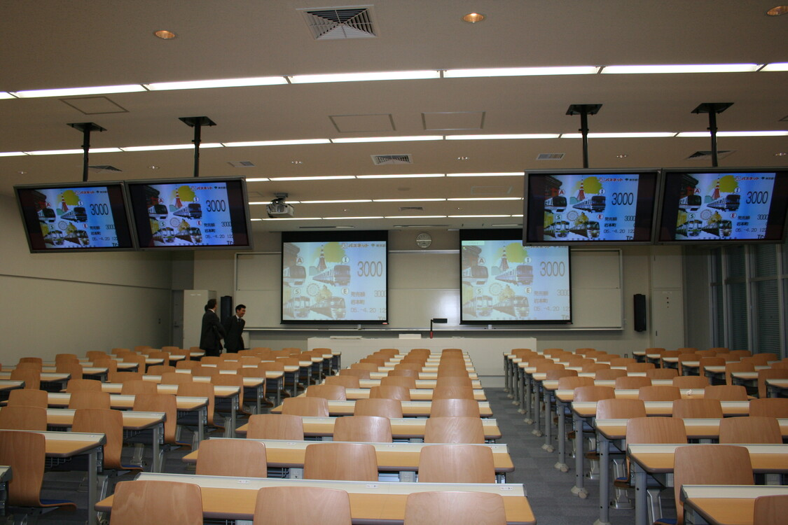 WolfVision Visualizer installed on a lectern at Meiji University