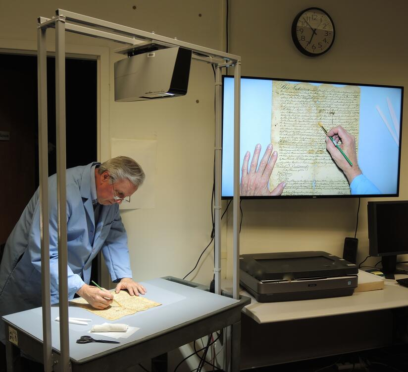 The VZ-C6 is used for instruction during a conservation treatment by Bill Minter, Senior Book Conservator