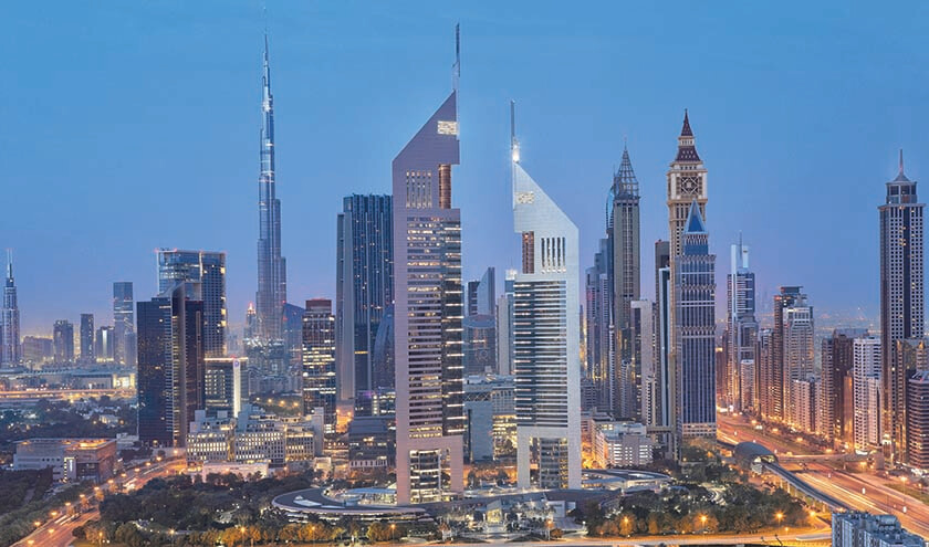 Dubai skyline with the Jumeirah Emirates Towers Hotel pictured in the foreground.